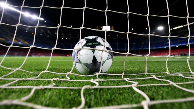 ball in football net photo
